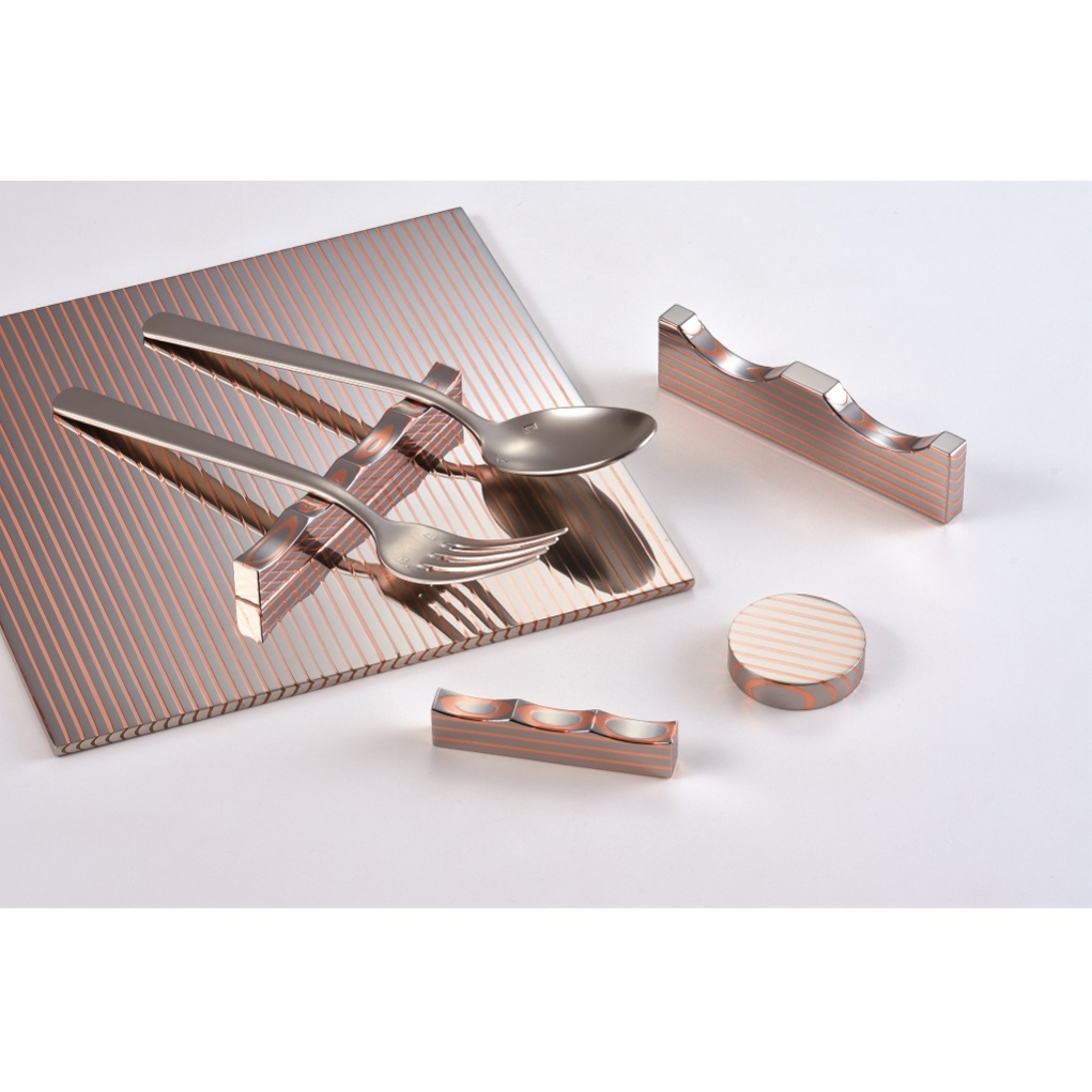 Clad steel cutlery rest